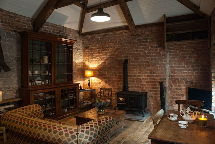 Living room with wood burning stove , wifi and satellite tv in peaceful serene surroundings