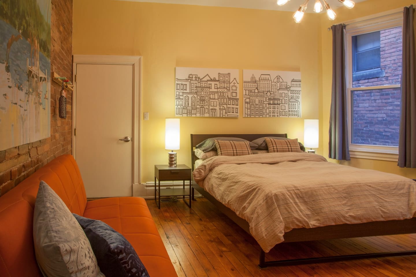 Your comfy, cozy queen bed featuring a brand new Tuft and Needle mattress and comfy pillows.