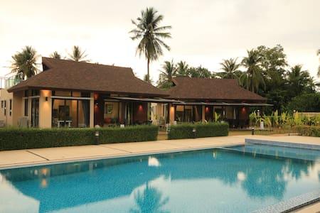 Stylish new 2 bedroom beachside pool villa