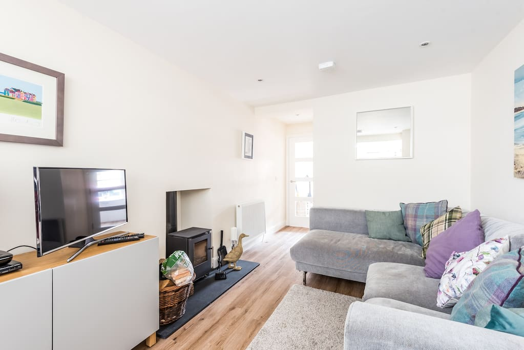 Large and comfortable lounge with a cosy wood-burner - perfect for cooler evenings