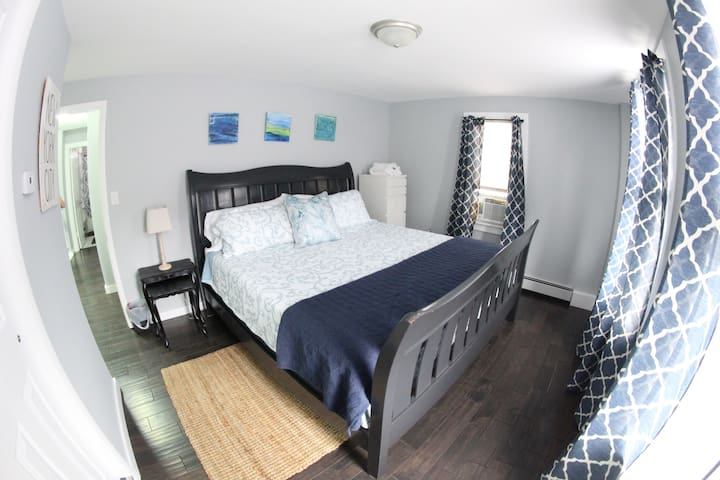 Master room with comfortable king size bed.
