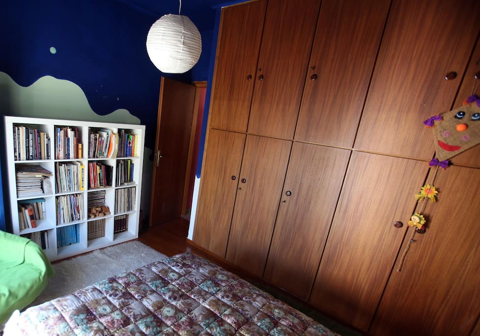 Bedroom. The library has mostly books of art, design, encyclopedias and comics.