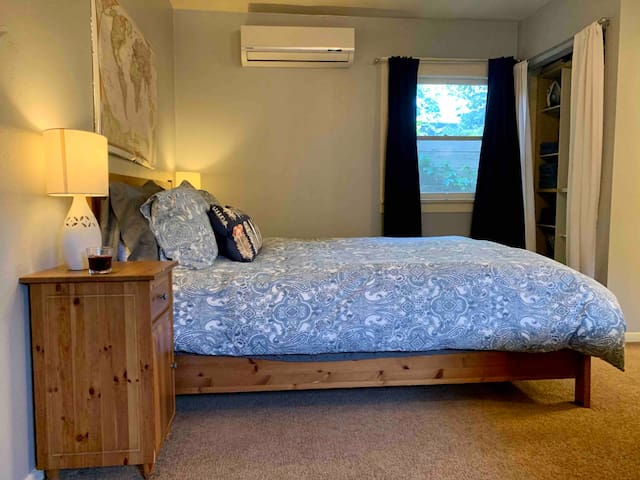 Bed is a queen size memory foam and very soft, with large comfy comforter.  AC and heat are above bed for quick, efficient heating and cooling.