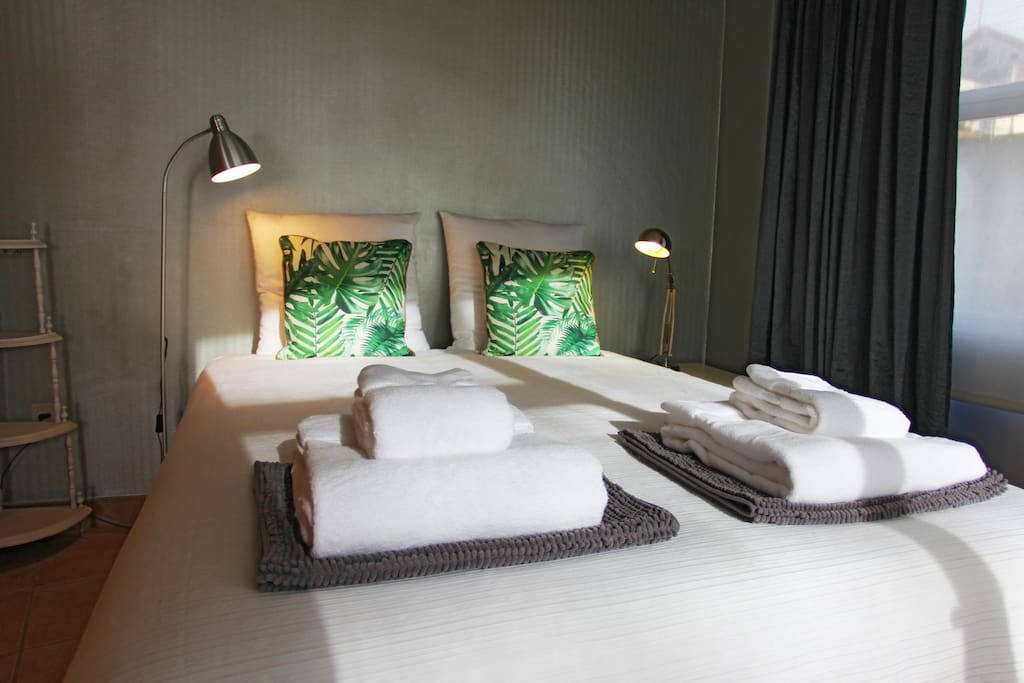 The Bedroom: A comfortable clean bed for two.