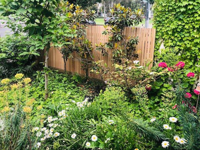 Lush garden surrounds.