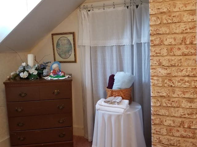 Bedroom comes with 4 towels and other linens include wash clothes and hand towel.  Hand crafted ceramics accessorize this room along with daughter's wedding floral arrangement.