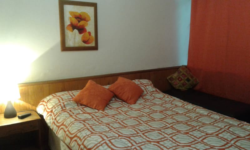 Casa acogedora ofrece: Pieza nº 4 Naranja