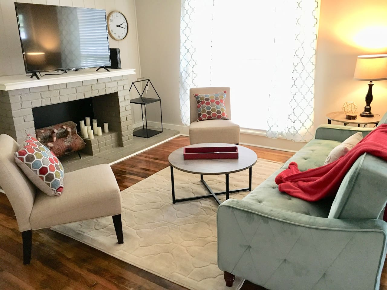"""Relax after a day of travel in our beautifully furnished living room. Use the 50"""" Smart TV to watch 20 local channels, or Netflix, Amazon Prime, ESPN+, or any number of other apps. The couch folds down to sleep another 2 guests."""