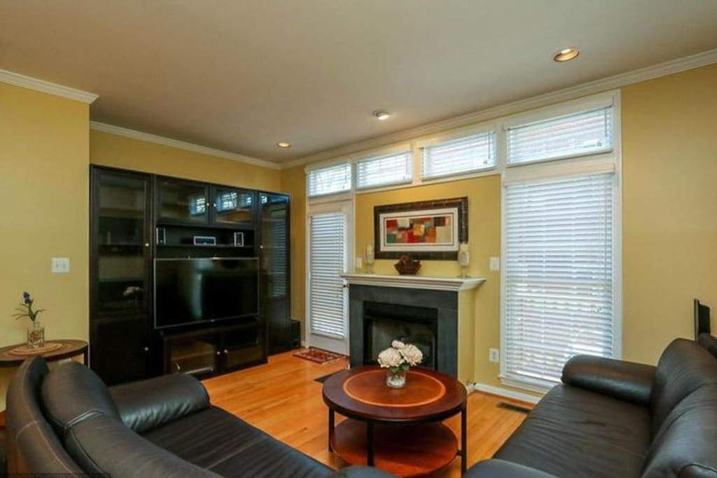 Living room with two cushy sofas, TV, fireplace