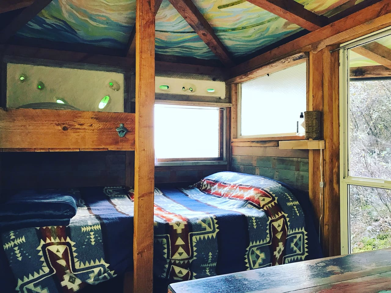 Sleeps two on a queen-ish size bed with a lofted space for personal items.