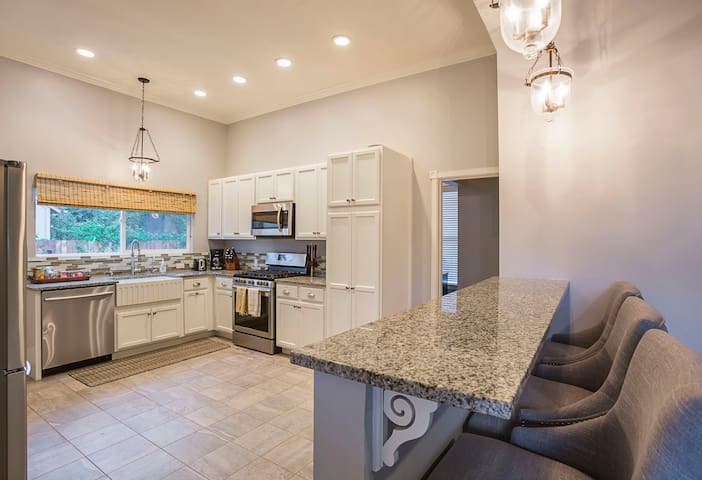 Breakfast bar and kitchen with granite countertops