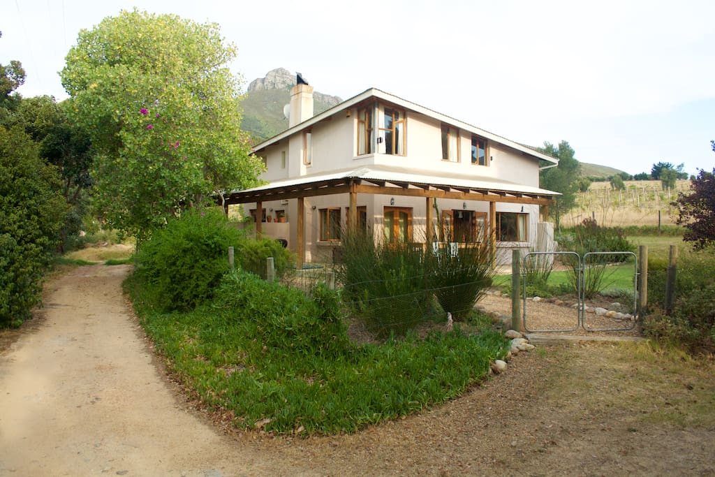 The house at the end of the farm road. Note the verandah with a 8 seater table, perfect for long sunny lunches.