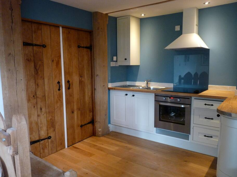 The fully equipped kitchen with large cupboards for coats & wellies etc.
