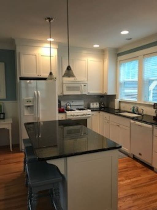 Full Kitchen with Island and Barstools