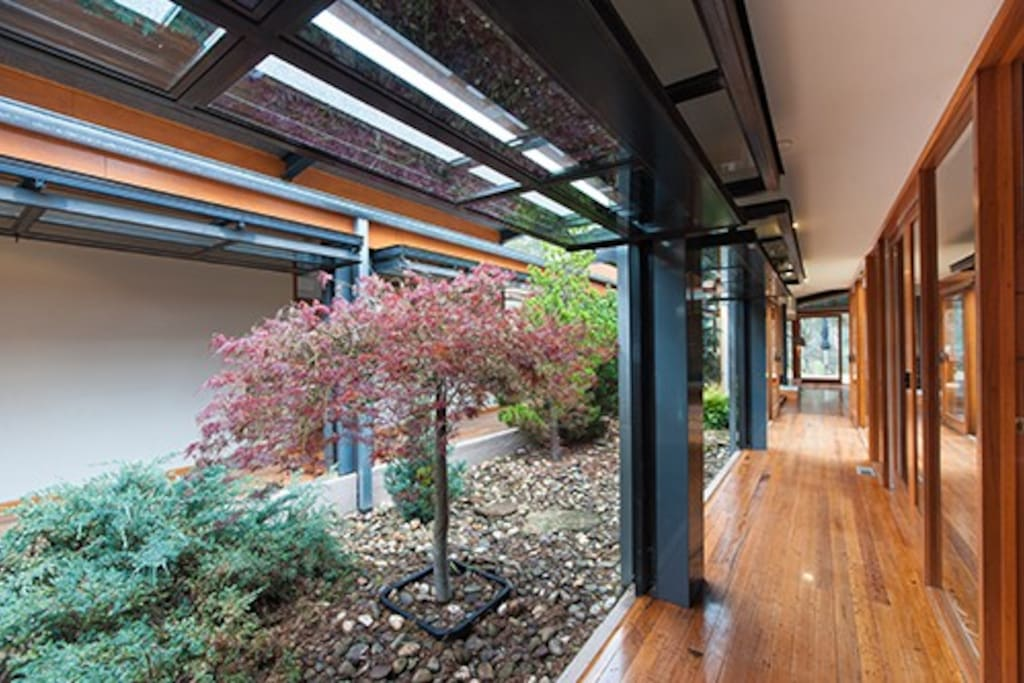 Amazing central fire station doors which create an outdoor space within the home