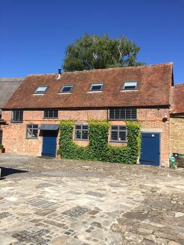 Historic Barn in village (yoga or tennis optional)