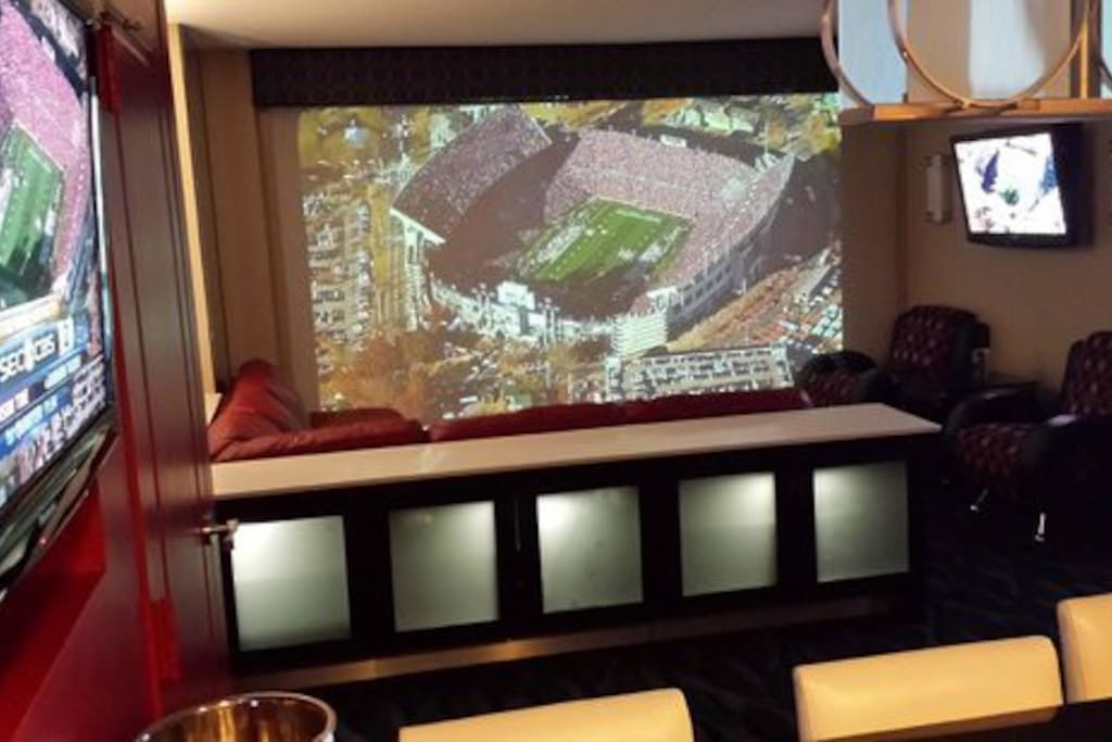 Window can turn into Floor to Ceiling TV with motorized projector screen