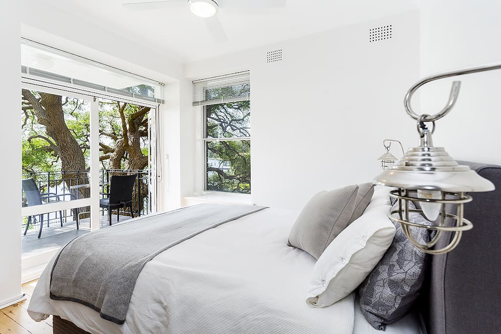 Master bedroom w adjoining balcony