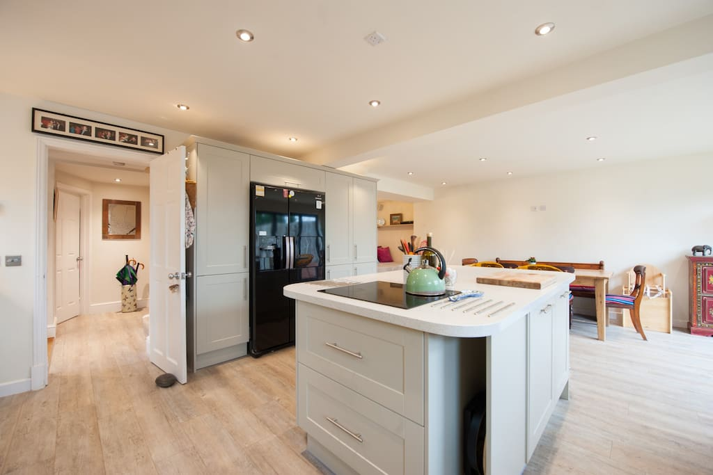Kitchen with american style fridge freezer and breakfast bar.