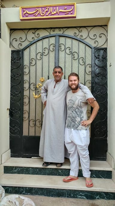 Ismael with a guest at the front door