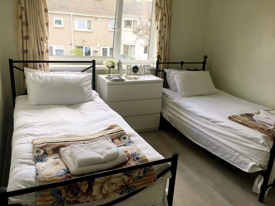 This is your room, bright, big size with 2 single beds and spare place for your suitcases.