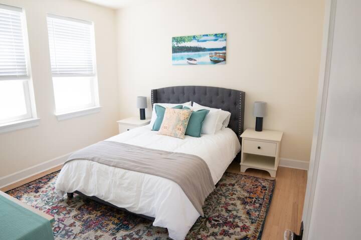 Second bedroom - Queen bed, dresser, closet