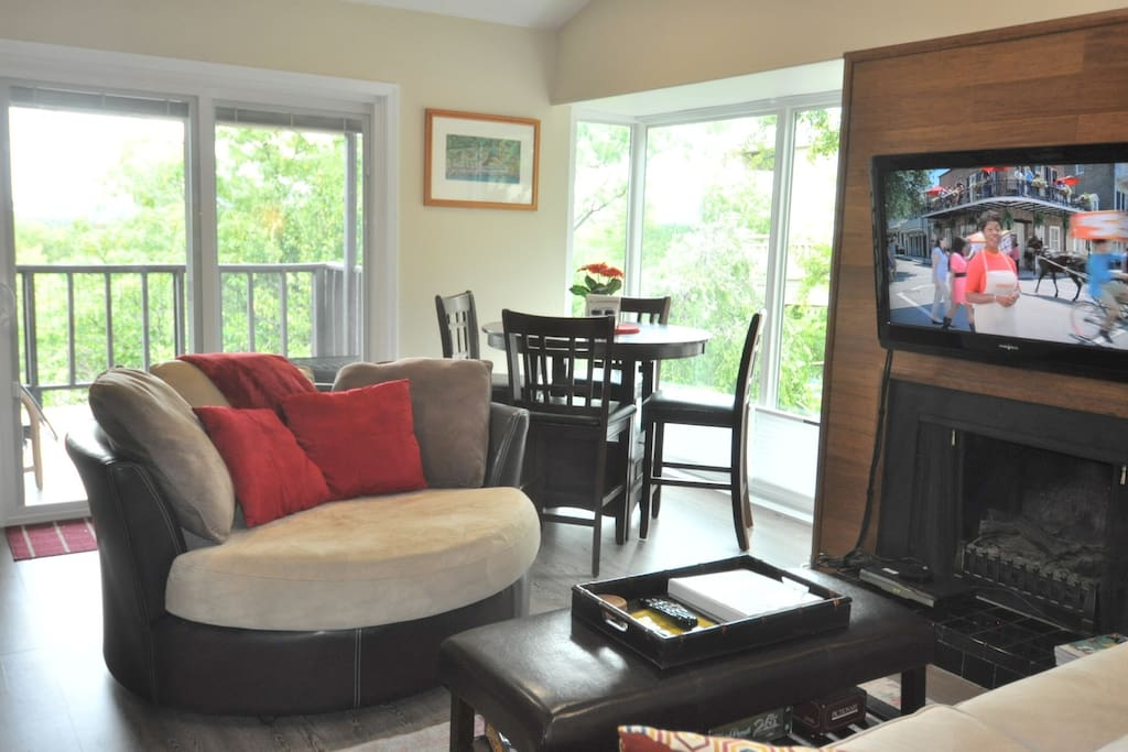 Round love seat can swivel around to see the view out of sliding door or floor to ceiling windows