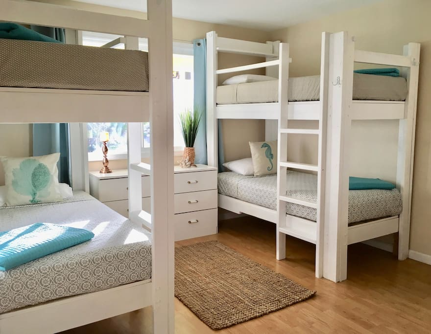 Bedroom 2 with two bunk beds and window AC unit