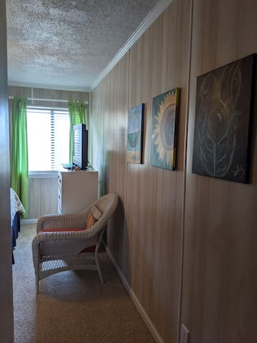 Art in the master bedroom is from a local Wine and Design location. Visit one while you're in the area!