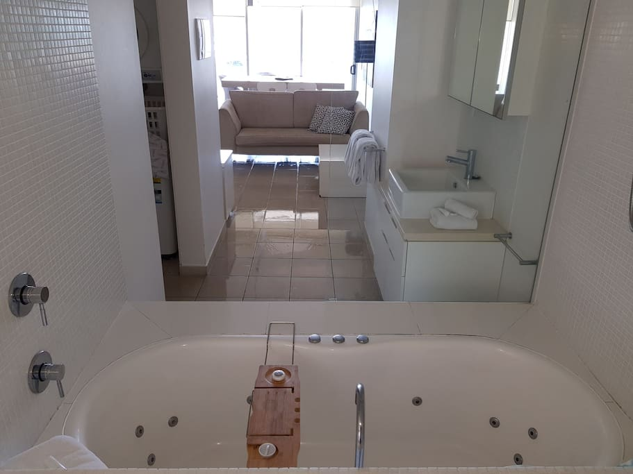Bathroom has shower over bath tub