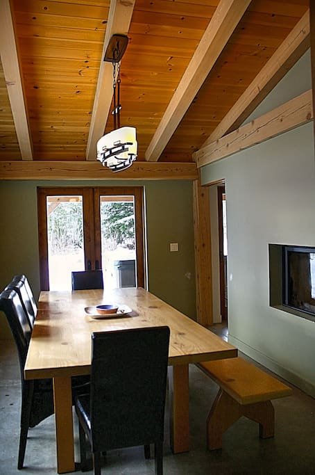 Large Dining area with Fireplace and Deck Access