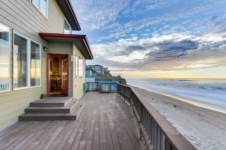 Roaring waves at this oceanfront beach rental with private hot tub & great views