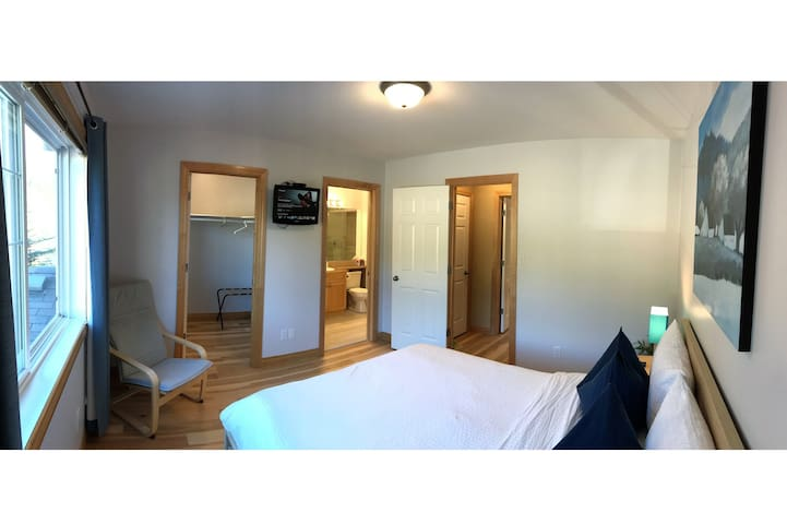 Large east facing 120 sq ft upper bedroom #1 with queen bed, private 3 piece bathroom and large walk in closet