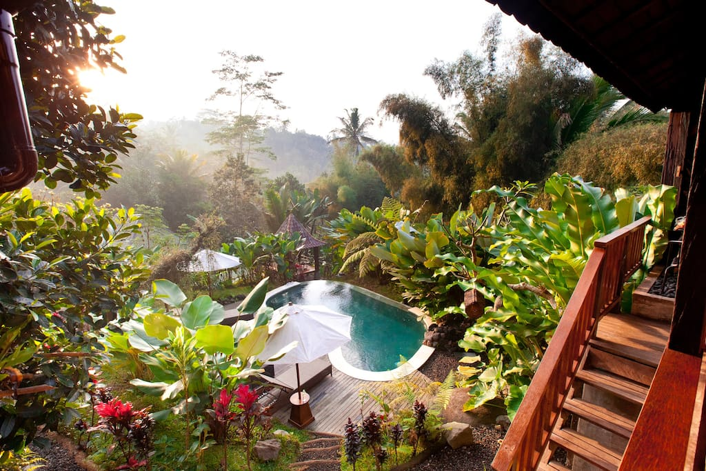 beautiful sunrise can be seen over the east side of the villa from Lumbung Sari room