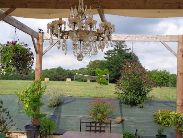 Dine alfresco under our chandelier with countryside back drop