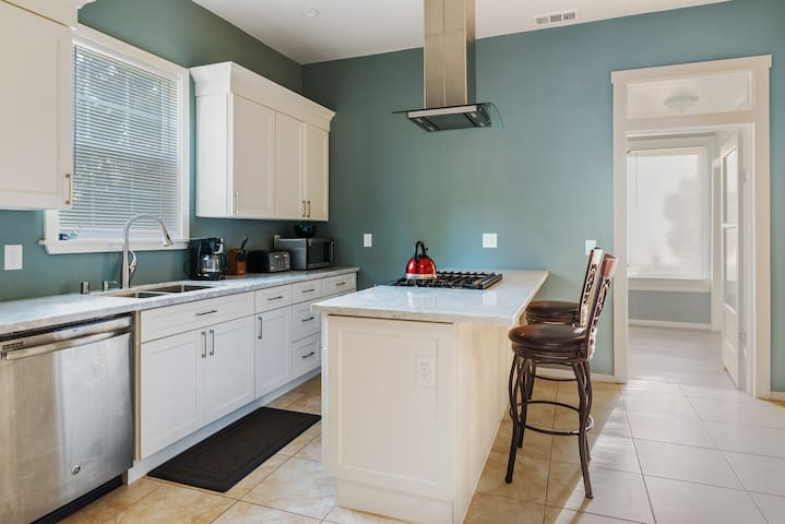 Kitchen with gas range + oven