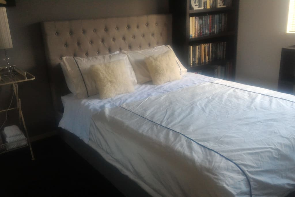 New queen size bed with pillow top mattress.