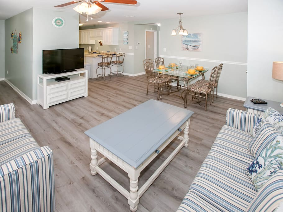 Welcome to your condo in Gulf Shores! The open living and dining space offers a great flow for entertaining.