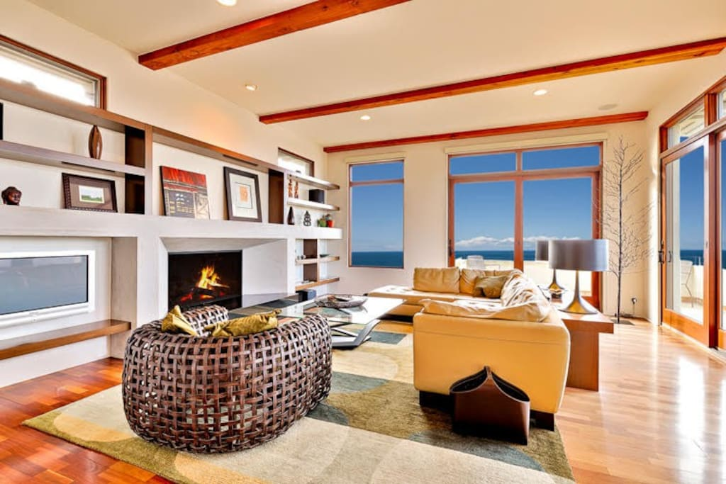 Cozy living area with fireplace and ocean views.