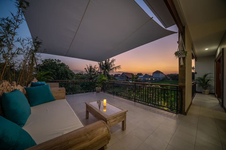 Sunset terrace with rice fields and romantic sunset