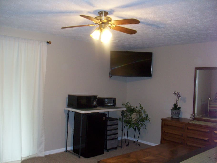 43' inch t.v., fridge, toaster oven, microwave and coffee maker