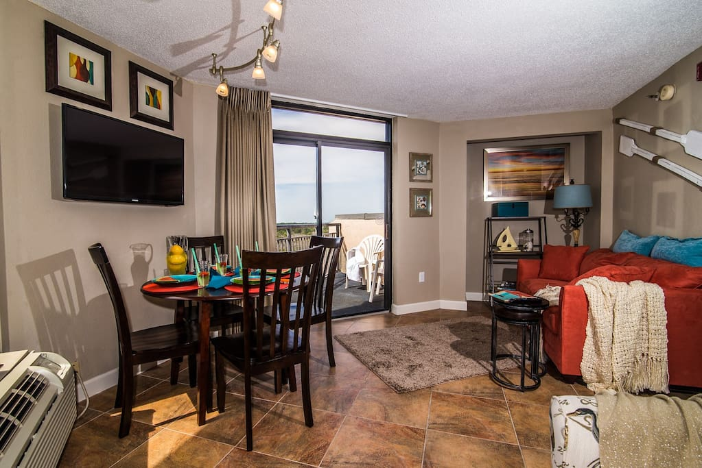 Open Living & Dining Areas with access to both  balconies