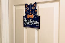 Guest room door. The room is he first on the right after you get passed them living room
