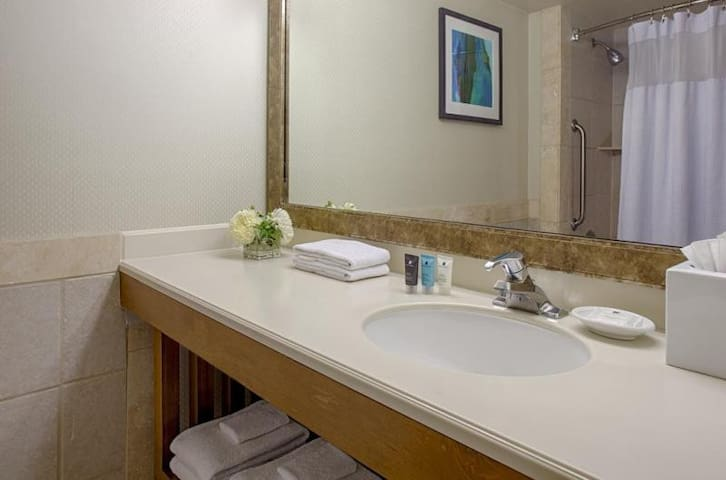 Updated bathroom with fresh linens replaced daily