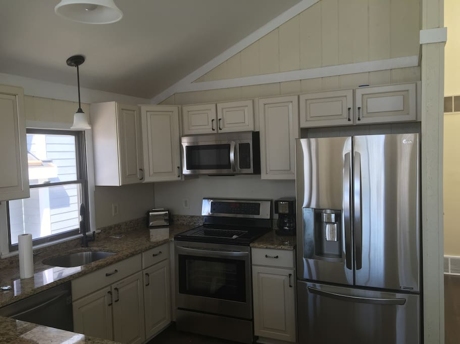 New kitchen, new appliances, hard wood floors and granite counter tops