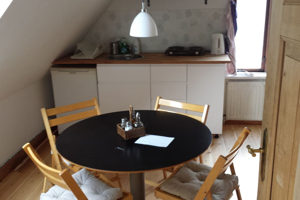 The dining table and the tea kitchen, as seen from the bedroom