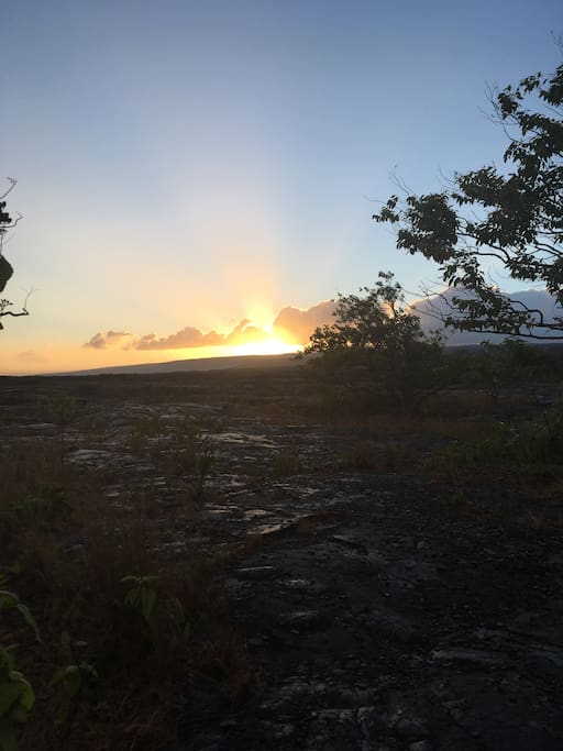 Watch the sun set over the lava in Kalapana