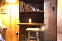 This is a cozy writing area for quick notes or for journaling.
