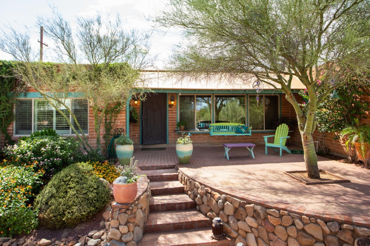 Secluded - yet 7 mins to Freeway;  - custom stonework front patio with porch swing.