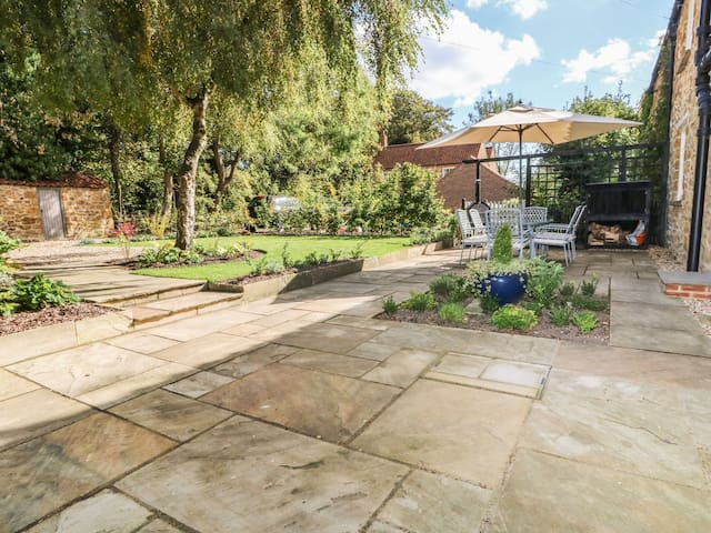 Private front garden with patio furniture, barbecue/pizza oven/patio heater, log store, boot store with boot cleaner, and two off-road parking spaces (one attached to property and one further up driveway)